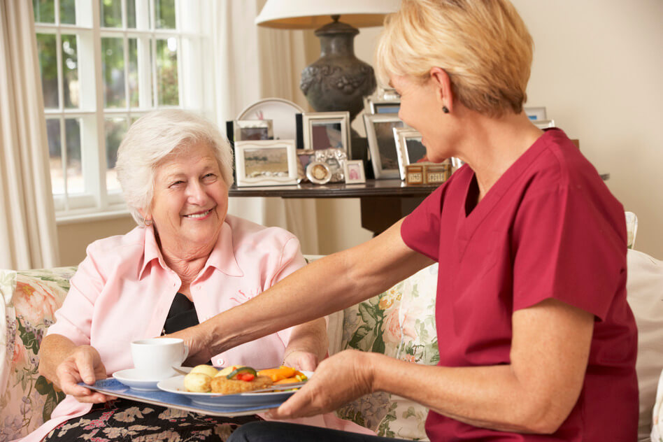 Serving Senior Woman Meal