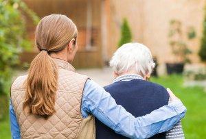 Caregiver Walking with Alzheimer's Patient
